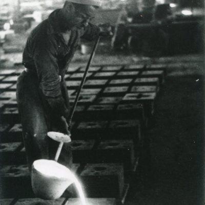 Man casting metal at I.S. Spencer's Sons.jpg