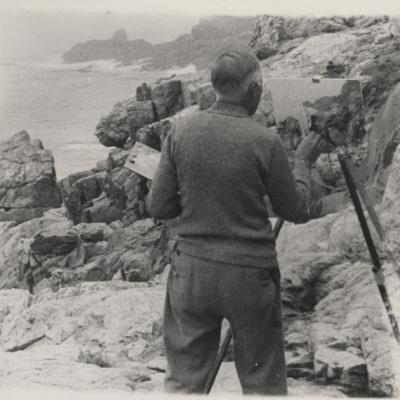 Charles Hubbard painting a scene on the Maine coastline