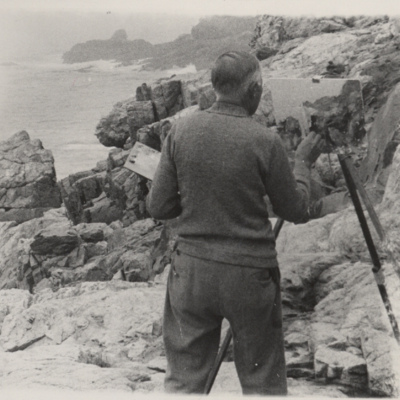 Charles Hubbard painting a scene on the Maine coastline